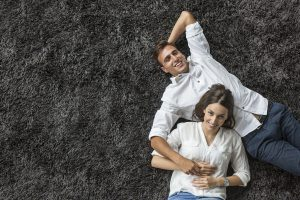 Couple Lying On Clean Carpet